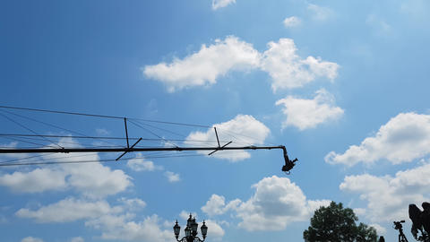 4K cinema production camera with crane in the blue sky Live Action