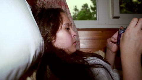 Tween playing with smartphone 29 Footage