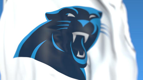 Flying flag with Carolina Panthers team logo, close-up. Editorial loopable 3D Live Action