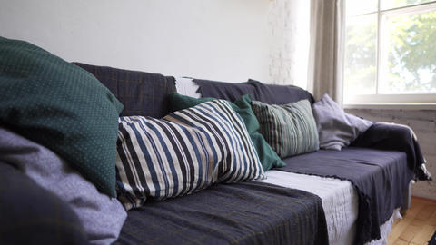 Hygge or Lagom concept - a cozy sofa with a lot of pillows and blankets with Live Action