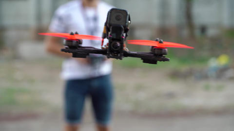 Male pilot manages FPV freestyle drone in flight Footage