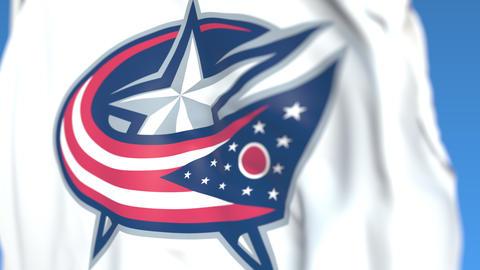 Waving flag with Columbus Blue Jackets NHL hockey team logo, close-up. Editorial Live Action