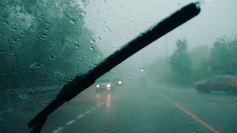 Car wipers cannot remove heavy rain from a car windshield during storm Live Action