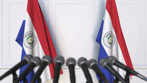 Paraguayan official press conference. Flags of Paraguay and microphones Live Action