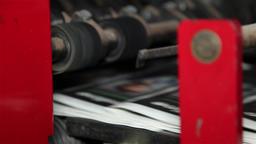final stage of newspaper being printed on a printing press Footage