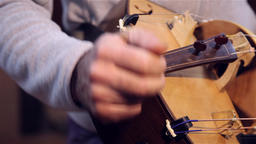 man playing old accordion called Sanfona Hurdy-gurdy stringed musical instrument Footage