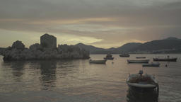 Seascape at sunset. Boats at sea in sunset light of the sun. Milocer. Montenegro Footage