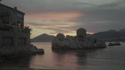 Beautiful sunset in the city by the sea. Seascape at sunset. Milocer. Montenegro Footage