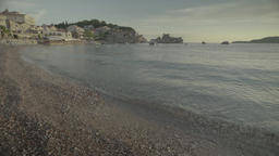 The seascape. Wide seashore at sunset . The beach in Milocer. Montenegro Live Action