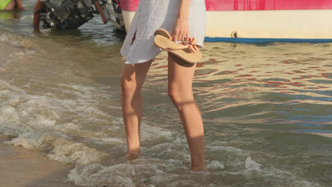 Beautiful women's feet are on the water. Girl on beach.Girl dancing in the water Live Action
