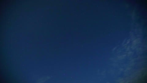 Timelapse of stars moving in night sky and falling, starry sky turning around Live Action