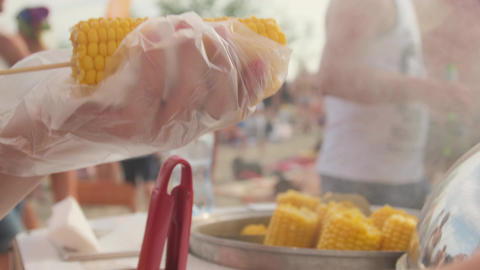 A street vendor sells corn.The seller sells corn on the beach.Close-up of corn Live Action