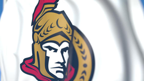 Waving flag with Ottawa Senators NHL hockey team logo, close-up. Editorial Live Action