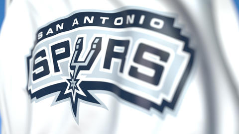 Flying flag with San Antonio Spurs team logo, close-up. Editorial loopable 3D Live Action