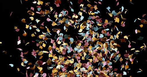 Confettis Falling against Black Background, Slow Motion 4K Live Action