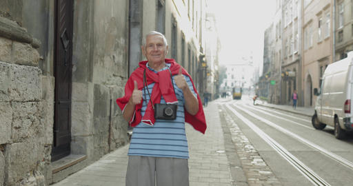 Happy senior male tourist dancing in city center. Traveling in Lviv, Ukraine Footage