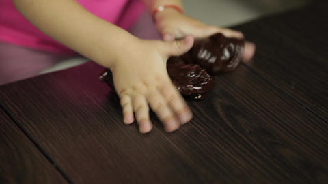 Child hands having fun with brown slime. Kid playing with hand made toy slime Footage