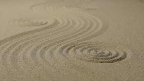 Refocusing the focus from the front circle to the far circle. Zen garden wit Footage