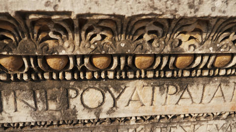 Old roman writing on the ancient column with beautiful details Live Action