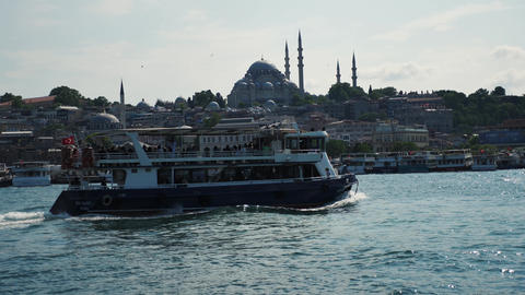 Big mosque in istanbul view from the bosphorus strait with boat passing by Live Action