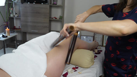 Masseur Massaging the Body Using Bamboo Sticks Footage