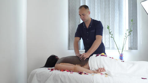 Masseur Applies Chocolate Mud Mask on Woman in Spa Salon Live Action