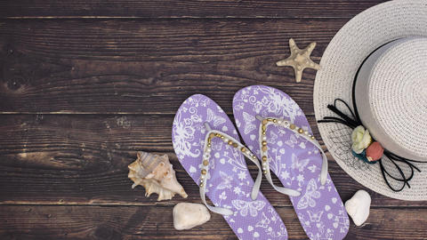 Woman's hat slippers book and shells on the wooden background - Stop motion Animation
