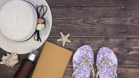 Summer kit and accessories for women on the wooden background - Stop motion Animation