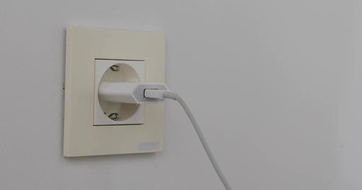 Plugging multiple power plugs into wall outlet Live Action