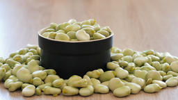 Zooming in at raw fava beans in a stoneware Live Action
