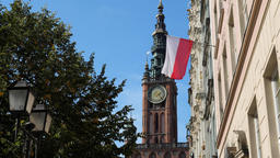 Town Hall building and Polish flag in Gdansk, Poland Live Action