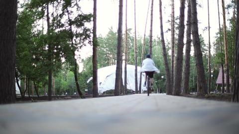 A boy rides on a bike Footage