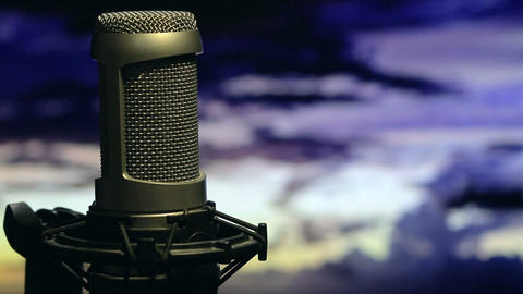 Isolated microphone on stand background cloudy sky Footage