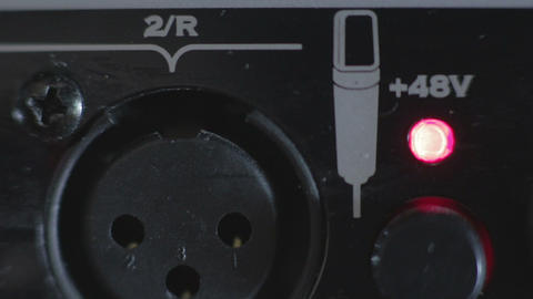 Closeup XLR microphone's socket ,turning on power Footage