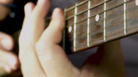 Slomo guitar playing angle left hand slide neck64 Footage