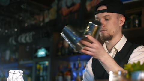 Guy-bartender shows the tricks Live Action