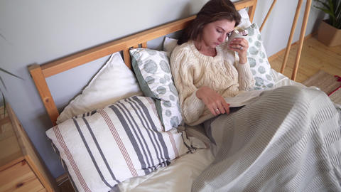 Coziness, happiness and comfort in the bedroom - the girl... Stock Video Footage
