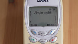 Obsolete Nokia phone is charging battery Live-Action