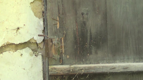 Old and abandoned house front door with handle Live Action