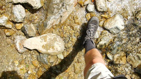 POV Trekking on stones and puddles Footage