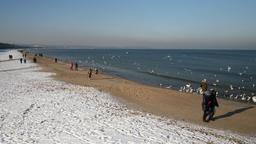 Winter in Gdansk, Poland. People walk along the beach on the bay of Gdansk Footage