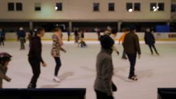 People ice skating. Ice skating rink. Defocused Footage