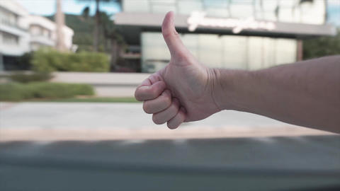 Enjoy trip concept. Hand is sticking out of car window, Yes, ok gesture. Happy traveler shot POV Footage