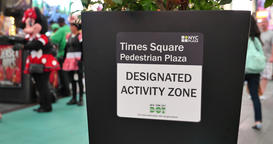 Sign Designates Approved Location in Times Square for Costumed Performers to Int Footage