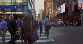 Pedestrians Walk in the Streets and Sidewalks of Manhattan Footage