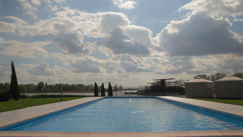 Clouds over the swimming pool timelapse Footage