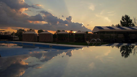 Reflected sunset and clouds over the swimming pool timelapse Footage