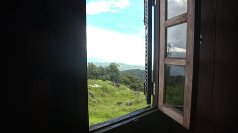Camera Moves to Open Window Shows Hilly Landscape Footage