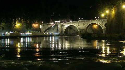 Rome Italy. Night view of a bridge on the River Tiber at Trastevere area Live Action