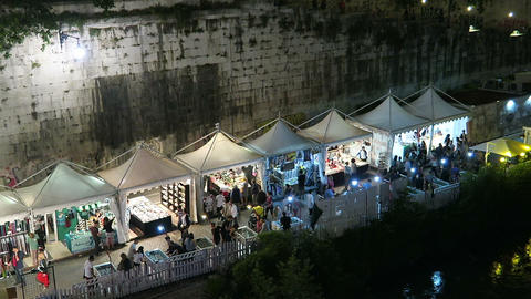 Rome Italy Summer 2016. Open air summer shops on river Tiber bank Live Action